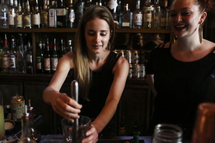 Emily bartending at Mandarin Hide